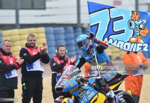Kalex EG0.0 Marc VSD 's Spanish rider Alex Marquez waves with his flag after the Moto2 race during the French Motorcycle Grand Prix, in Le Mans,...