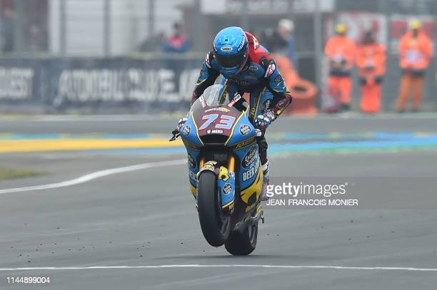 Kalex EG0.0 Marc VSD's Spanish rider Alex Marquez crosses the finish line and wins the Moto2 race during the French Motorcycle Grand Prix, in Le...