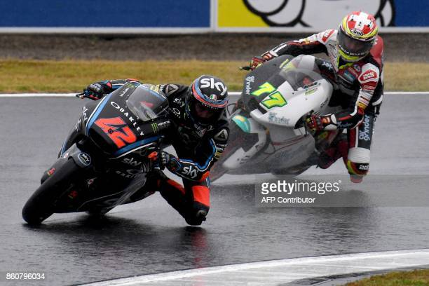 Kalex rider Francesco Bagnaia of Italy leads Suter rider Dominique Aegerter of Switzerlands during the Moto2class second practice session of the...