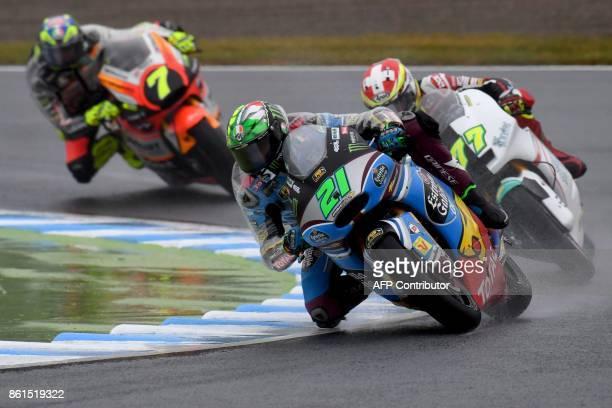 Kalex rider Franco Morbidelli of Italy leads Suter rider Dominique Aegerter of Switzerland and Kalex rider Lorenzo Baldassarri of Italy during the...