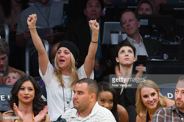 Kaley Cuoco and Briana Cuoco attend a basketball game between the Sacramento Kings and the Los Angeles Lakers at Staples Center on March 17 2013 in...