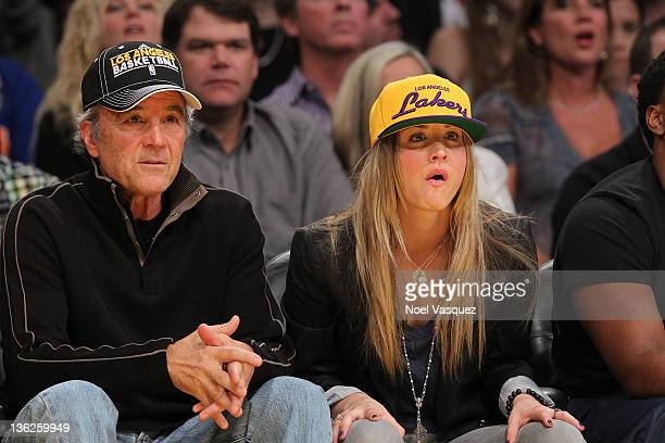 Kaley Cuoco and her father Gary Cuoco attend the Los Angeles Lakers vs New York Knicks game on December 29 2011 in Los Angeles California