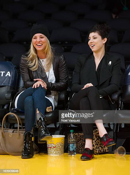 Kaley Cuoco and her sister Briana Cuoco attend a basketball game between the Sacramento Kings and the Los Angeles Lakers at Staples Center on March...