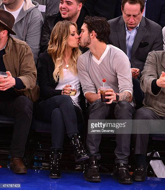 Kaley Cuoco and Ryan Sweeting attend the Dallas Mavericks vs New York Knicks game at Madison Square Garden on February 24 2014 in New York City