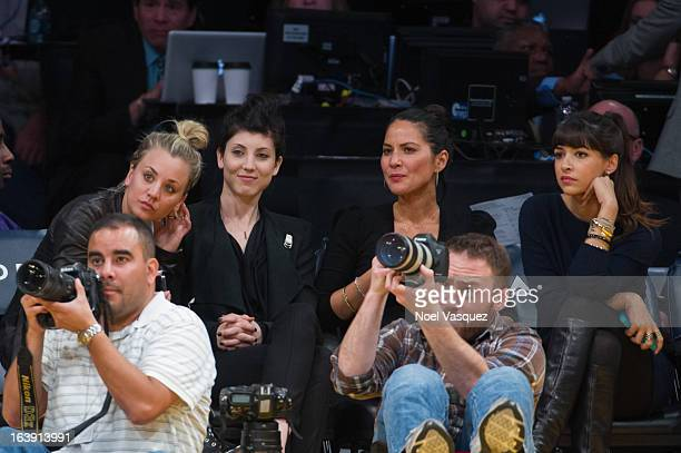 Kaley Cuoco Briana Cuoco and Olivia Munn attend a basketball game between the Sacramento Kings and the Los Angeles Lakers at Staples Center on March...