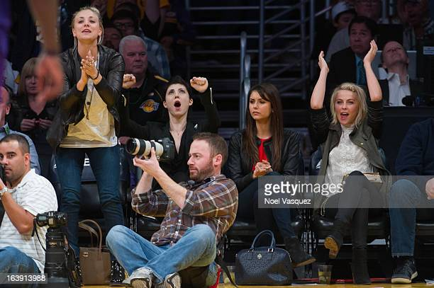 Kaley Cuoco Briana Cuoco Julianne Hough and Nina Dobrev attend a basketball game between the Sacramento Kings and the Los Angeles Lakers at Staples...