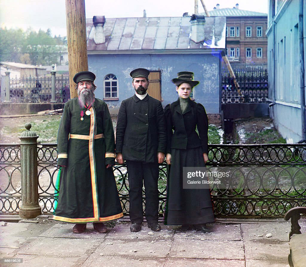 A. P. Kalganov (left) with his son and granddaughter in Zlatoust in the Ural Mountain region of Russia, 1910. The son and granddaughter both work at the Zlatoust arms factory, which produces swords for the military.