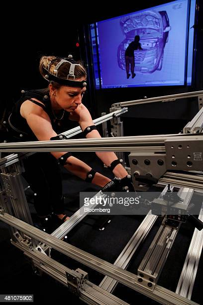 Kali Gawinski an ergonomist with Ford Motor Co reaches around a virtual 2016 Ford Explorer at Ford's Ergonomics and Variation Analysis Lab in...