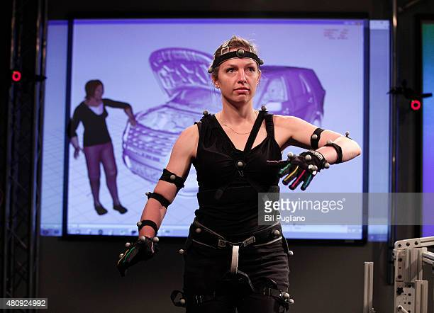 Kali Gawinski of Windsor, Ontario, wears a Motion Capture suit as she demonstrates motion capture virtual reality technology at the new Ford...
