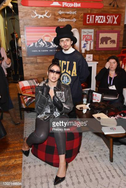 Kali Uchis and Moises Arias of 'Blast Beat' attend the Pizza Hut x Legion M Lounge during Sundance Film Festival on January 26 2020 in Park City Utah