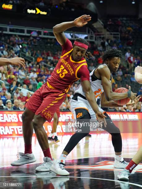 Kalib Boone of the Oklahoma State Cowboys rebounds the ball against Solomon Young of the Iowa State Cyclones in the second half during the first...