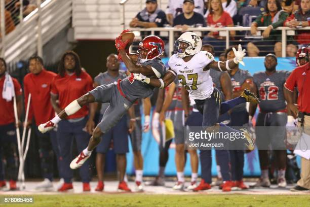 Kalib Woods of the Florida Atlantic Owls catches a fourth quarter touchdown in front of Brad Muhammad of the Florida International Golden Panthers at...