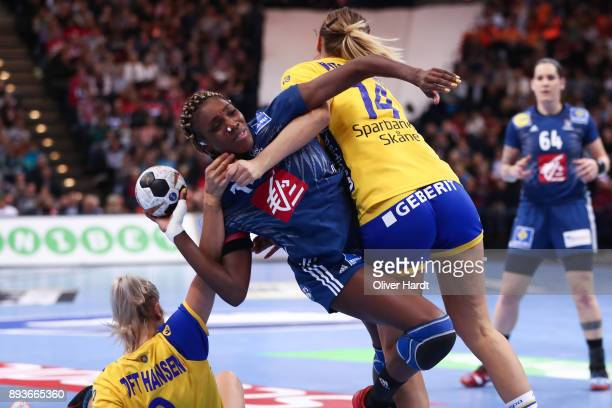 Kalidiatou Niakate of France and Ulrika Toft Hansen and Johanna Westberg of Sweden challenges for the ball during the IHF Women's Handball World...