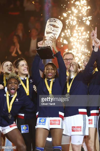Kalidiatou Niakatem and Siraba Dembele of France celebrate with the trophy after the IHF Women's Handball World Championship final match between...