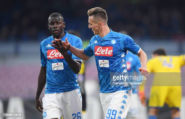 Kalidou Koulibaly and Arkadiusz Milik of SSC Napoli celebrate the 30 goal scored by Arkadiusz Milik during the Serie A match between SSC Napoli and...