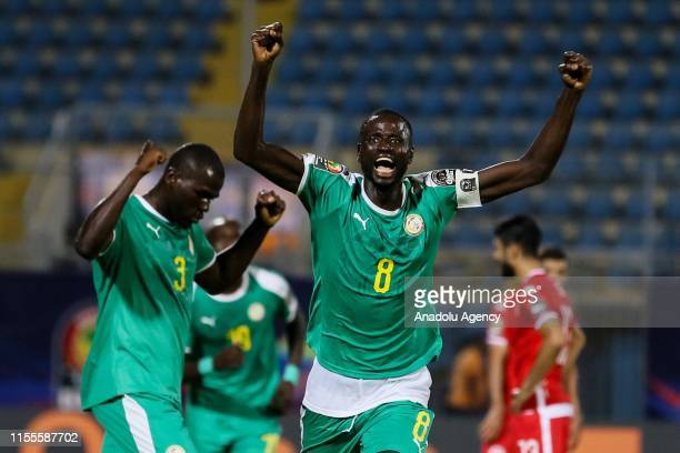 Kalidou Koulibaly and Cheikhou Kouyate of Senegal celebrate at the end of the 2019 Africa Cup of Nations semifinal football match between Tunisia and...