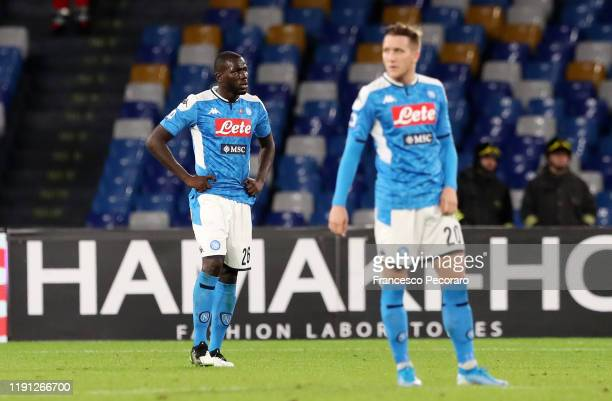 Kalidou Koulibaly and Piotr Zielinski of SSC Napoli stand disappointed during the Serie A match between SSC Napoli and Bologna FC at Stadio San Paolo...