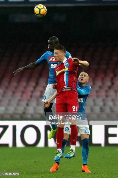 Kalidou Koulibaly of Napoli competes for the ball in air with Bartosz Salamon of Spal during the serie A match between SSC Napoli and Spal at Stadio...