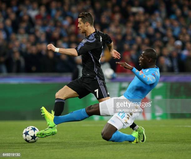 Kalidou Koulibaly of Napoli competes for the ball with Cristiano Ronaldo of Real Madrid during the UEFA Champions League Round of 16 second leg match...