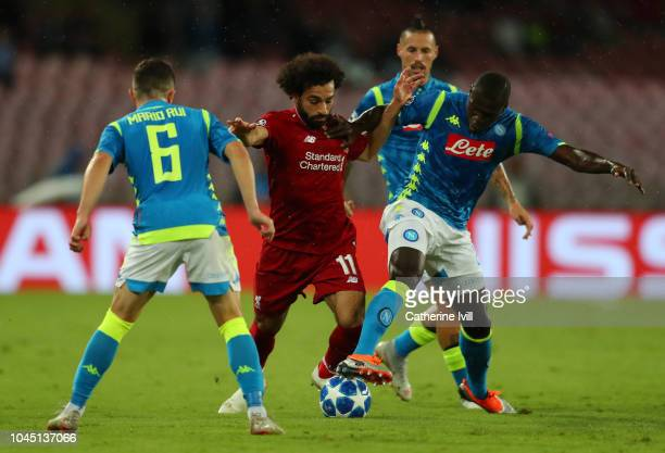 Kalidou Koulibaly of Napoli is challanged by Mohamed Salah of Liverpool during the Group C match of the UEFA Champions League between SSC Napoli and...