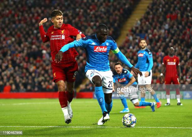 Kalidou Koulibaly of Napoli is put under pressure by Roberto Firmino of Liverpool during the UEFA Champions League group E match between Liverpool FC...