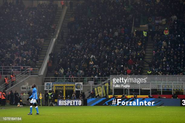 Kalidou Koulibaly of Napoli leaves the pitch after a red card during the Serie A match between FC Internazionale and SSC Napoli at Stadio Giuseppe...