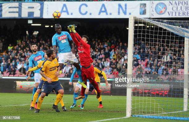 Kalidou Koulibaly of Napoli scores his team's opening goal during the serie A match between SSC Napoli and Hellas Verona FC at Stadio San Paolo on...