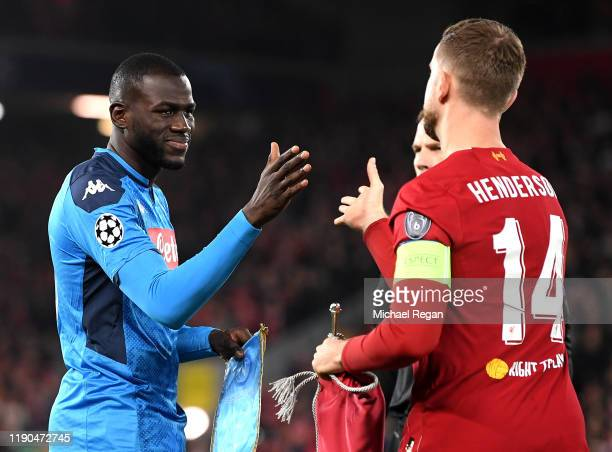 Kalidou Koulibaly of Napoli shakes hands with Jordan Henderson of Liverpool prior to the UEFA Champions League group E match between Liverpool FC and...
