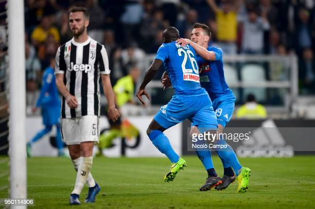 Kalidou Koulibaly of SSC Napoli celebrates with Arkadiusz Milik after scoring a goal as Miralem Pjanic of Juventus FC is disappointed during the...