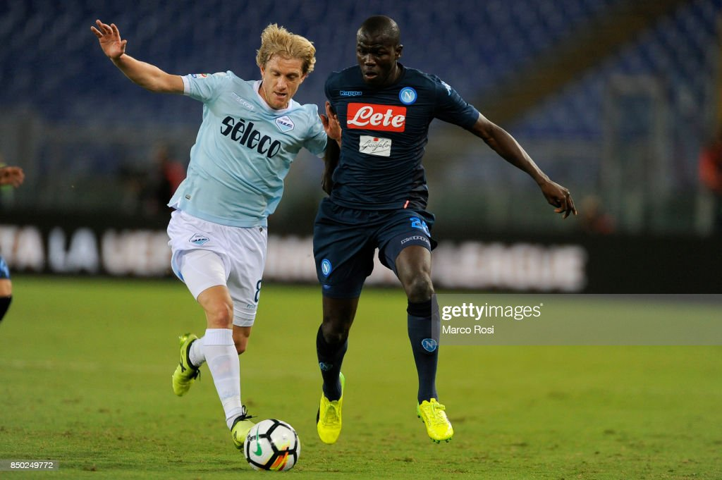 Kalidou Koulibaly of SSC Napoli compete for the ball with Dusan Basta of SS Lazio during the Serie A match between SS Lazio and SSC Napoli at Stadio Olimpico on September 20, 2017 in Rome, Italy.