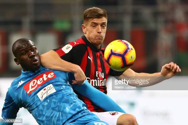 Kalidou Koulibaly of SSC Napoli competes for the ball with Krzysztof Piatek of AC Milan during the Coppa Italia match between AC Milan and SSC Napoli...