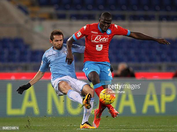 Kalidou Koulibaly of SSC Napoli competes for the ball with Senad Lulic of SS Lazio during the Serie A match between SS Lazio and SSC Napoli at Stadio...