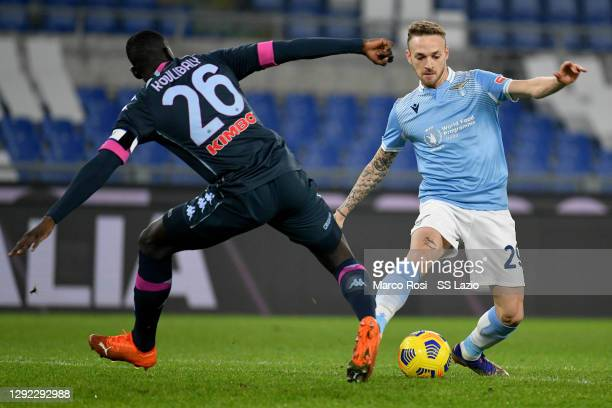 Kalidou Koulibaly of SSC Napoli compte for the ball with Manuel Lazzari of SS Lazio during the Serie A match between SS Lazio and SSC Napoli at...