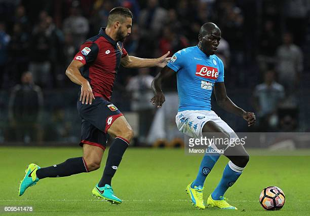 Kalidou Koulibaly of SSC Napoli is challenged by Leonardo Pavoletti of Genoa CFC during the Serie A match between Genoa CFC and SSC Napoli at Stadio...