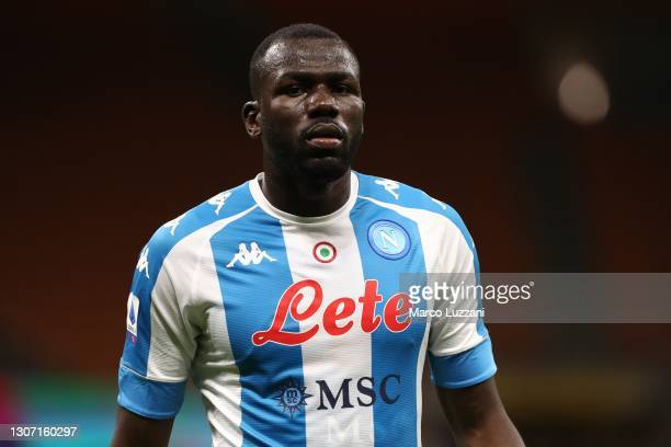 Kalidou Koulibaly of SSC Napoli looks on during the Serie A match between AC Milan and SSC Napoli at Stadio Giuseppe Meazza on March 14, 2021 in...