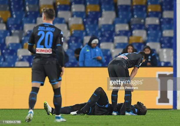 Kalidou Koulibaly of SSC Napoli reacts after being injured during the Serie A match between SSC Napoli and Parma Calcio at Stadio San Paolo on...