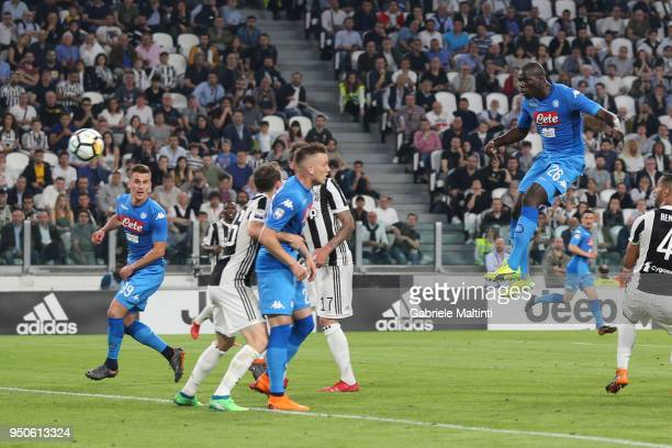 Kalidou Koulibaly of SSC Napoli scores a goal during the serie A match between Juventus and SSC Napoli on April 22 2018 in Turin Italy