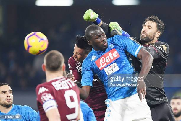 Kalidou Koulibaly of SSC Napoli vies Alex Berenguer and Salvatore Sirigu of Torino FC during the Serie A match between SSC Napoli and Torino FC at...