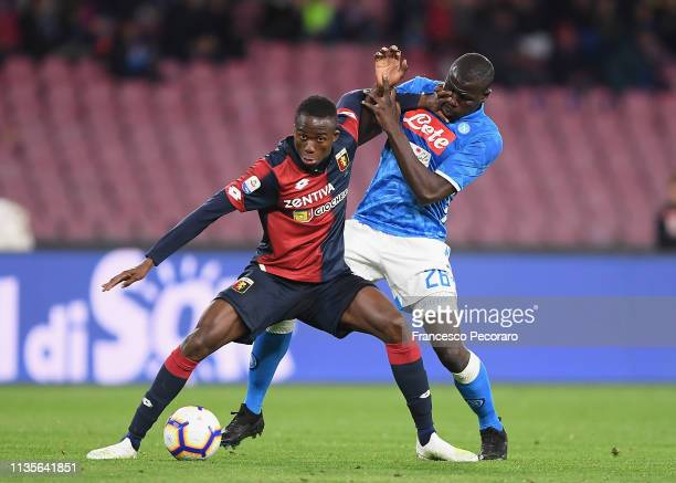 Kalidou Koulibaly of SSC Napoli vies Christian Kouamè of Genoa CFC during the Serie A match between SSC Napoli and Genoa CFC at Stadio San Paolo on...