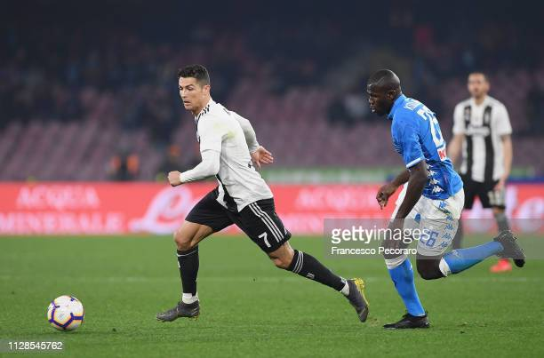Kalidou Koulibaly of SSC Napoli vies Cristiano Ronaldo of Juventus during the Serie A match between SSC Napoli and Juventus at Stadio San Paolo on...