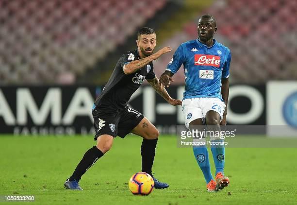 Kalidou Koulibaly of SSC Napoli vies Francesco Caputo of Empoli during the Serie A match between SSC Napoli and Empoli at Stadio San Paolo on...