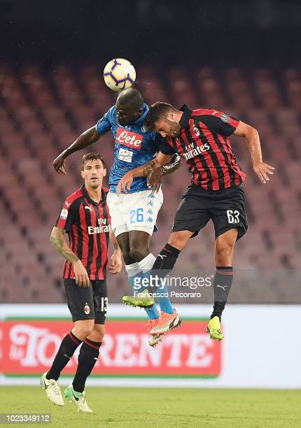 Kalidou Koulibaly of SSC Napoli vies Patrick Cutrone of AC Milan during the serie A match between SSC Napoli and AC Milan at Stadio San Paolo on...
