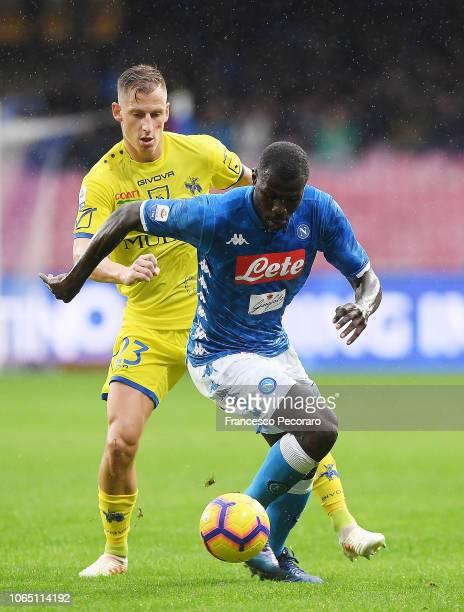 Kalidou Koulibaly of SSC Napoli vies Valter Birsa of Chievo Verona during the Serie A match between SSC Napoli and Chievo Verona at Stadio San Paolo...