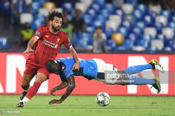 Kalidou Koulibaly of SSC Napoli vies with Mohamed Salah of Liverpool FC during the UEFA Champions League group E match between SSC Napoli and...