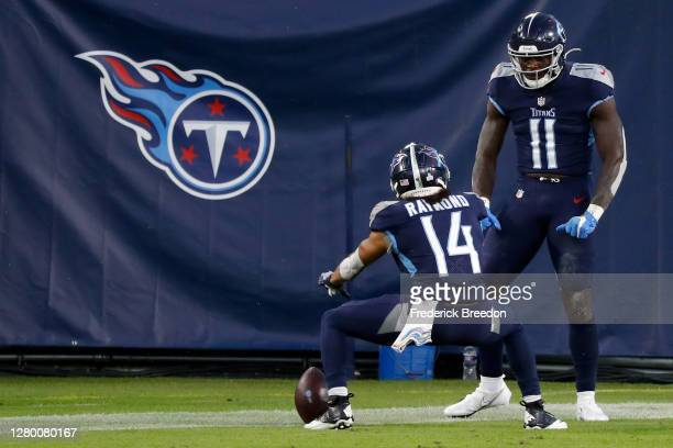 Kalif Raymond and A.J. Brown of the Tennessee Titans celebrate after Brown scored a touchdown in the first quarter against the Buffalo Bills at...