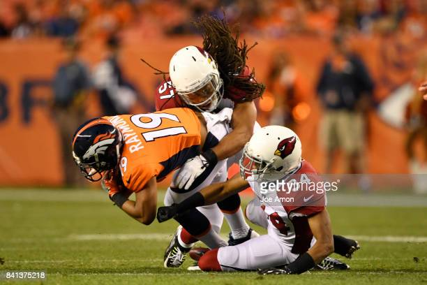 Kalif Raymond of the Denver Broncos is brought down by Josh Bynes of the Arizona Cardinals and Harlan Miller during the first quarter of action. The...