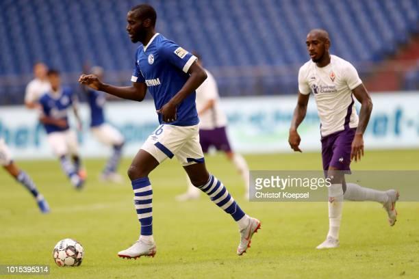 Kalif Sane of Schalke runs with the ball during the friendly match between FC Schalke 04 v AFC Fiorentina at Veltins Arena on August 11 2018 in...