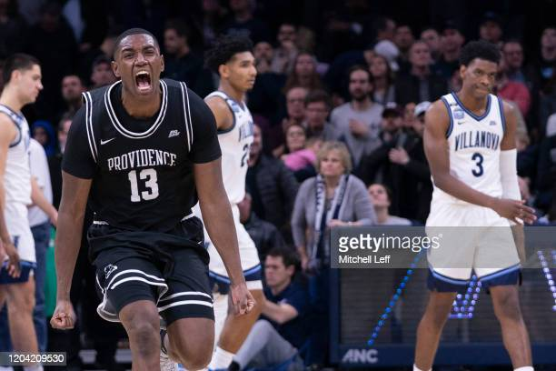 Kalif Young of the Providence Friars reacts in front of Jermaine Samuels and Brandon Slater of the Villanova Wildcats after the game at the Wells...