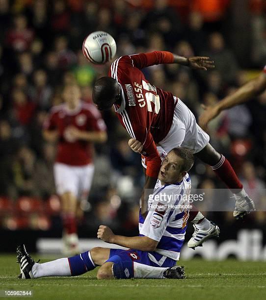 Kalifa Cisse of Bristol battles with Heidar Helguson of QPR during the npower Championship match between Bristol City and Queens Park Rangers at...
