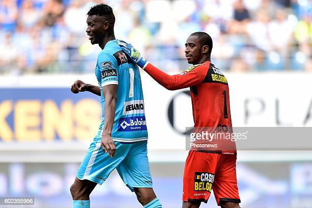 Kalifa Coulibaly forward of KAA Gent is comforted by Barry Boubacar Copa goalkeeper of Sporting Lokeren during the Jupiler Pro League match between...